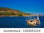 semi sunken boat on the shore...   Shutterstock . vector #1203051214