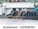 A Dredger Ship Dissolves Water...