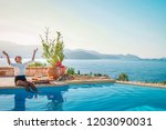 breakfast by the swimming pool... | Shutterstock . vector #1203090031