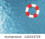 Red Lifebelt on the Water - stock photo