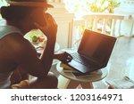 man sitting talking the mobile...   Shutterstock . vector #1203164971