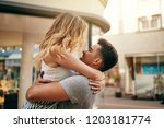 young couple embracing and... | Shutterstock . vector #1203181774