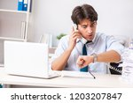 overloaded busy employee with...   Shutterstock . vector #1203207847