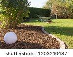 distribute bark mulch on the... | Shutterstock . vector #1203210487