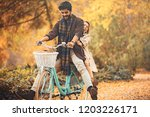 young smiling couple enjoying... | Shutterstock . vector #1203226171