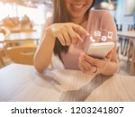 asian woman hand using... | Shutterstock . vector #1203241807