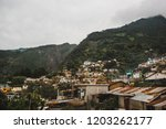 the small mountain town of... | Shutterstock . vector #1203262177