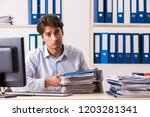 overloaded busy employee with...   Shutterstock . vector #1203281341