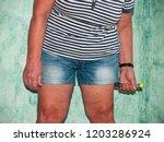 an allergic woman injecting an... | Shutterstock . vector #1203286924