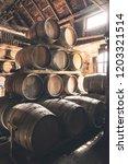 wine barrels in barn   large... | Shutterstock . vector #1203321514