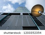 looking up at modern corporate... | Shutterstock . vector #1203352354