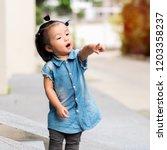 close up cute little girl asian ... | Shutterstock . vector #1203358237