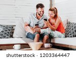 couple using smartphones in... | Shutterstock . vector #1203364447
