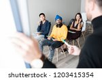 serious concentrated young...   Shutterstock . vector #1203415354
