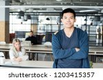 happy young asian male intern... | Shutterstock . vector #1203415357