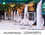 empty wine glass on the banquet ... | Shutterstock . vector #1203434551