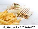 beef tacos served with golden...   Shutterstock . vector #1203444037