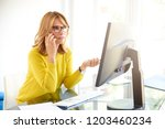 shot of middle aged investment... | Shutterstock . vector #1203460234