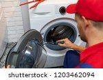 repairman with screwdriver... | Shutterstock . vector #1203462094