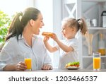 healthy food at home. happy... | Shutterstock . vector #1203466537
