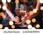 friends celebrating christmas... | Shutterstock . vector #1203469894