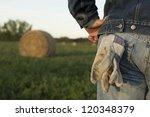 A Farmer Stands In A Field In...