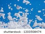 white soap foam on a blue sky...   Shutterstock . vector #1203508474