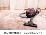 vacuum cleaner in the room on... | Shutterstock . vector #1203517744