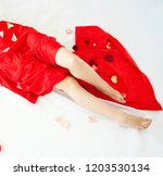 woman in red lying in bed with... | Shutterstock . vector #1203530134