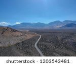 beautiful endless desert road... | Shutterstock . vector #1203543481