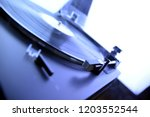 turntable vinyl record player... | Shutterstock . vector #1203552544