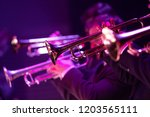 A trumpet section of a big band dressed in black