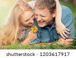 happy couple having fun together | Shutterstock . vector #1203617917