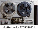 old reel to reel recorder with... | Shutterstock . vector #1203634051