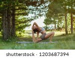 young yoga instructor...   Shutterstock . vector #1203687394
