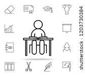 a schoolboy at a desk icon.... | Shutterstock .eps vector #1203730384