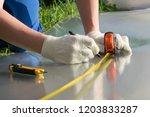 master measures tape measure... | Shutterstock . vector #1203833287