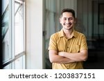 young man asian smiling and...   Shutterstock . vector #1203837151