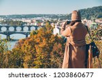 woman taking picture on her... | Shutterstock . vector #1203860677