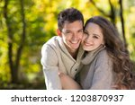 young beautiful couple in... | Shutterstock . vector #1203870937