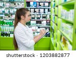young and beautiful chemist... | Shutterstock . vector #1203882877