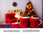 two cups with a knitted cover... | Shutterstock . vector #1203903904