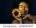 lovely african woman with a...   Shutterstock . vector #1203924337