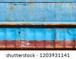 blue cargo ship hull with red... | Shutterstock . vector #1203931141