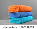 folded clean towels on grey... | Shutterstock . vector #1203948874