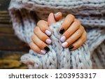 luxury short manicure  on a... | Shutterstock . vector #1203953317