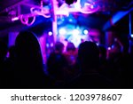 couple in  small club watching... | Shutterstock . vector #1203978607