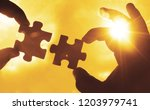 two hands of businessman to...   Shutterstock . vector #1203979741