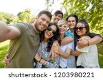 leisure  people and friendship... | Shutterstock . vector #1203980221