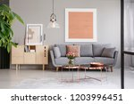 large painting on a gray wall... | Shutterstock . vector #1203996451